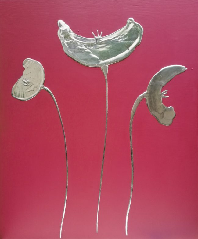 silver poppies on red artwork